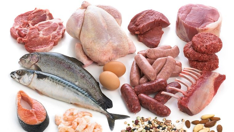 Selection of fish and meats against a white background.