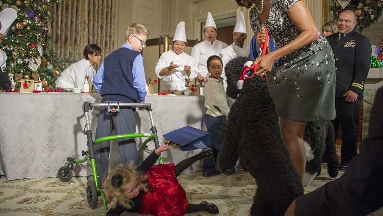 Michelle Obama pulls Sunny back as a little girl falls to the floor.