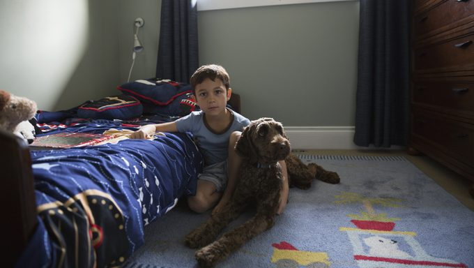kid in bedroom with dog