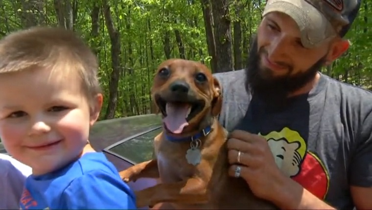 Mason and his dog are held by his Grandma and father.