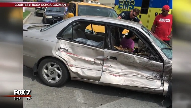 The car's passenger doors are smashed in.