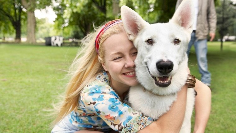 blonde, girl, floral shirt, white dog, grass, trees, park, summer fun, pets, real people