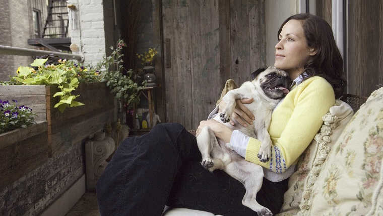 Woman sitting with small dog
