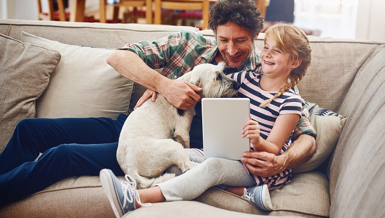 Cropped shot of a father and his little daughter using a digital tablet at home