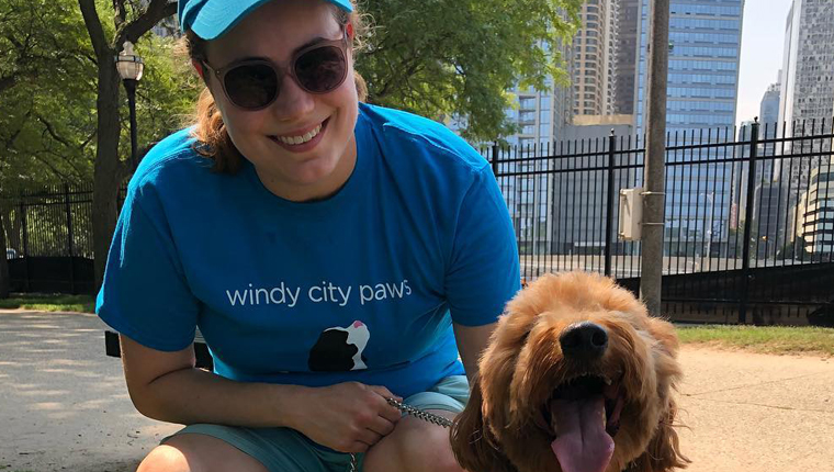 dog walker poses with pooch