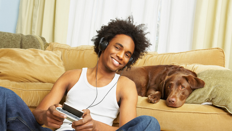 man listening to podcasts with dog
