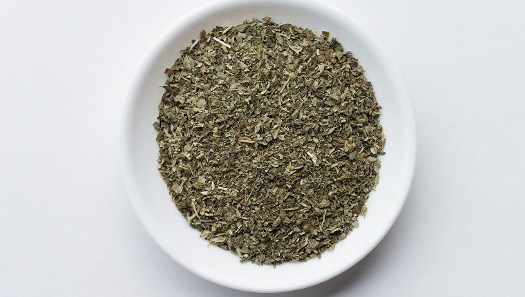 High Angle View Of Catnip In Bowl Over White Background