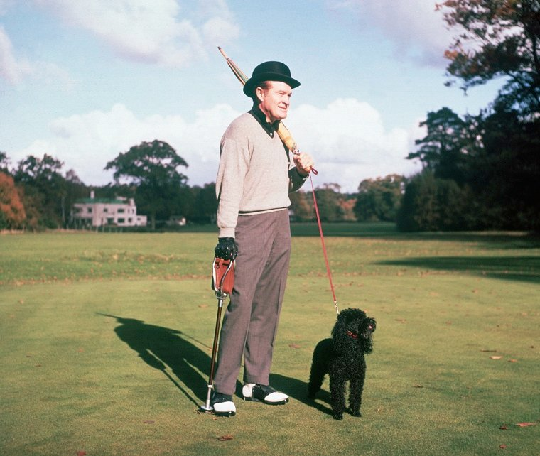 Actor And Comedian Bob Hope Plays Golf With His Dog