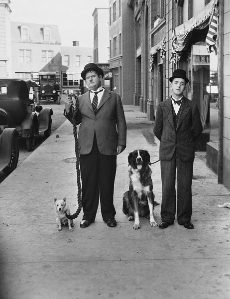 Laurel And Hardy Take A Break From Filming On Set To Walk Their Pups